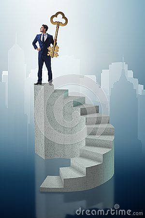 The businessman with key to success at the top of career Stock Photo