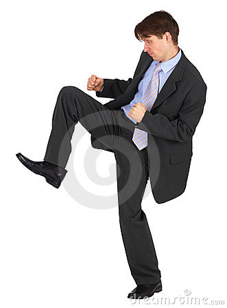 Businessman kicks down on white background