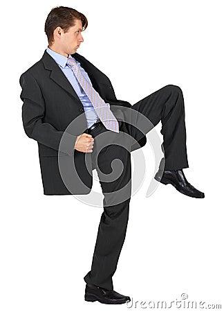 Businessman knee kick on white background