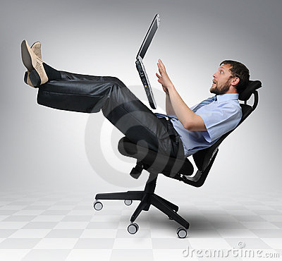 Businessman with laptop falls from an chair