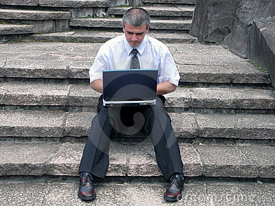 Businessman with laptop outdoor