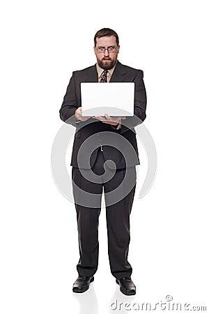 Businessman laptop wide eyed expression