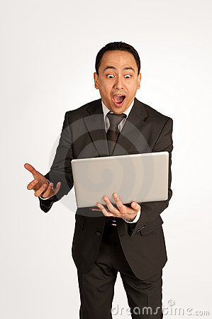 Businessman with laptop and winning expression