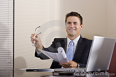 Businessman with laptop working in boardroom