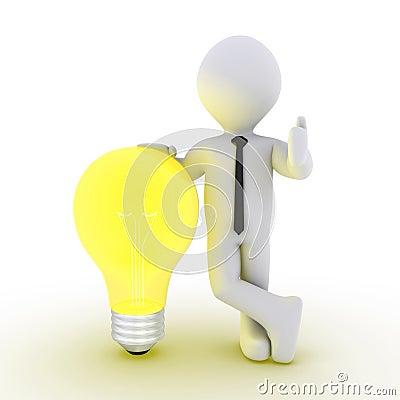 Businessman leaning on light bulb