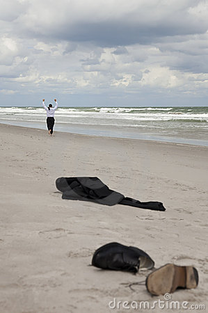 Businessman Leaving Clothes On Beach Running Away