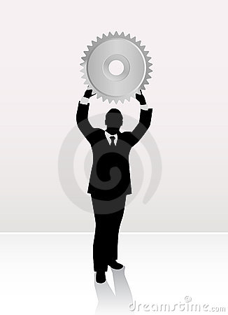 Businessman lifting wheel