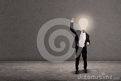 Businessman with lightbulb head raised arm