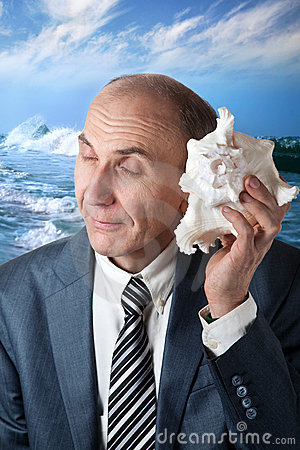 Businessman listening to the shell