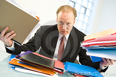Businessman loaded with work