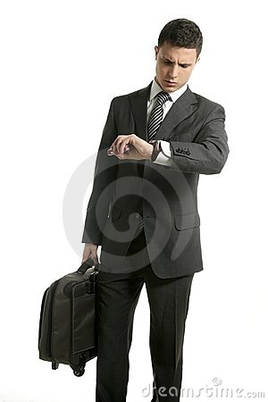 Businessman look his watch with handbag