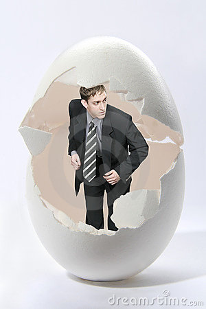 Businessman look out big egg