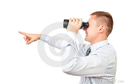 Businessman looking through binocular