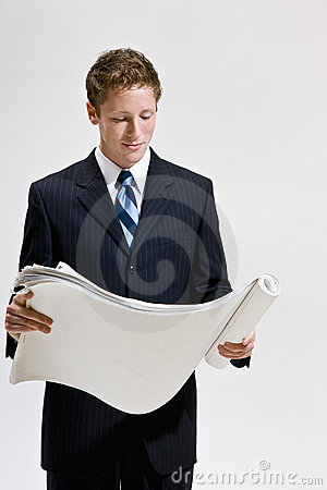 Businessman looking at blueprints