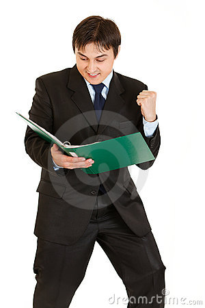 Businessman looking in folder with documents