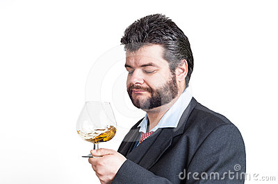 Businessman looking at a glass of whisky