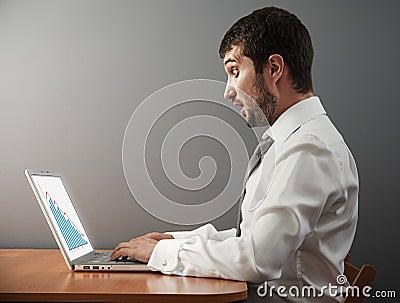 Businessman looking at graph