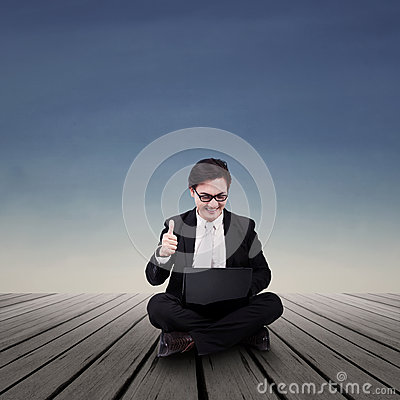 Businessman looking at laptop outdoor