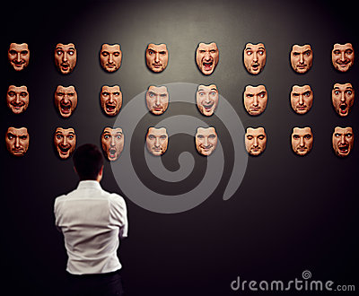 Businessman looking at mask