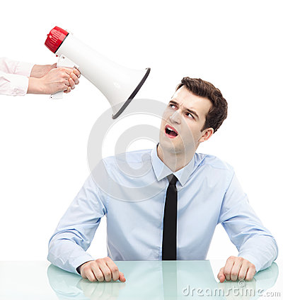 Businessman looking at megaphone