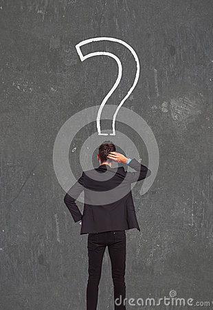 Businessman looking at question mark