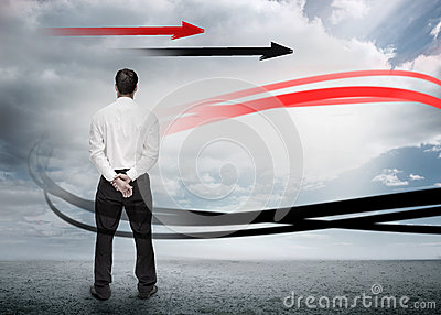 Businessman looking at red and black arrows