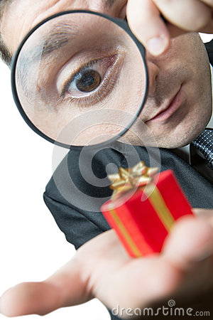 Businessman looking at a small present