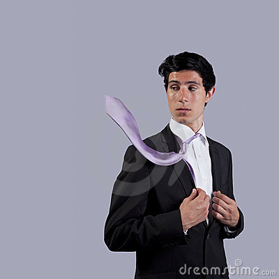 Businessman looking to his flying necktie