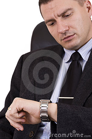 Businessman looking watch