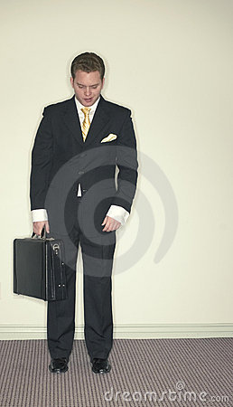 Businessman looks down