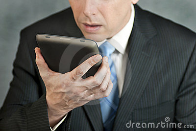 Businessman Looks At Tablet With Despair