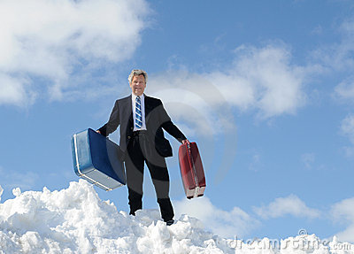 Businessman, Luggage and Snow