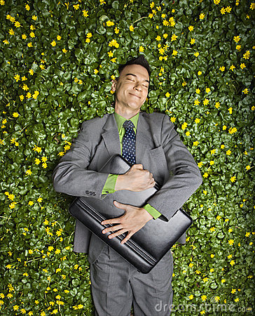 Free Businessman Lying In Flower Patch Royalty Free Stock Photo - 12723495
