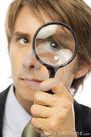 Businessman magnifies