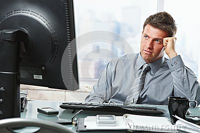 Businessman making decision in office