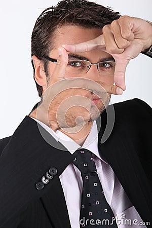Businessman making a frame
