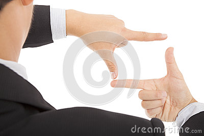 Businessman making frame with hands