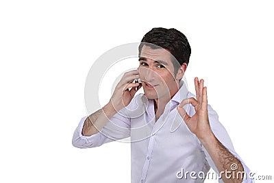 Businessman making OK gesture
