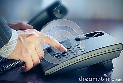 The businessman making a phone call.