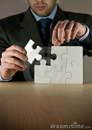Businessman Making A Puzzle