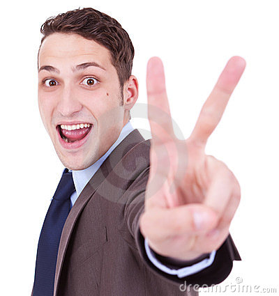 Businessman making the victory hand gesture