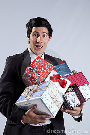 Businessman with many gift packages
