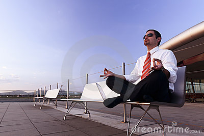 Businessman meditating.