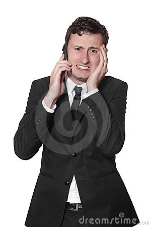 Businessman with a mobile phone and headache