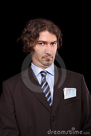 Businessman with money in his pocket