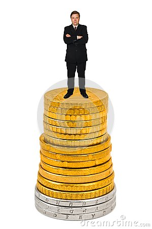 Businessman on money stack
