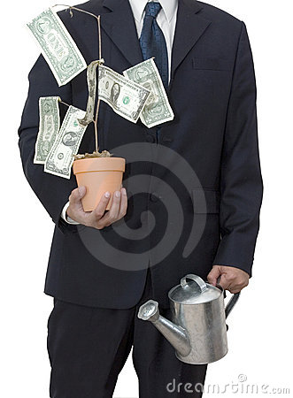 Businessman with money tree
