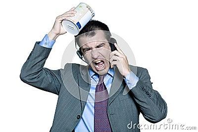 businessman moneybox shouting on phone