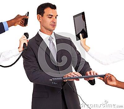 Businessman multiple gadgets