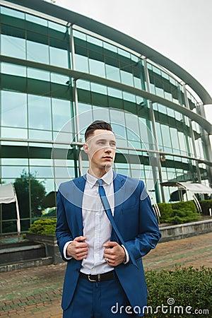 Businessman near office building